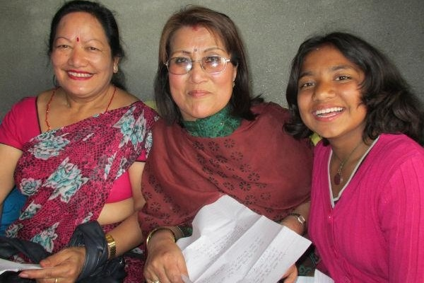 Rupa (right) with her Teachers